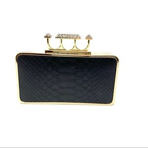 BCBGMAXAZRIA Embossed Rhinestone Knuckle Clutch